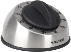 Appareil de gestion du temps équipé d'un bouton pour le réglage et d'une alarme.