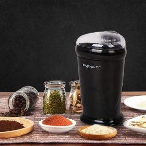 Appareil pour moudre les graines de café conçu en plastique.